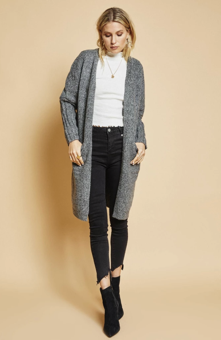 Beatnik Fine Goods Jenna Cardigan ($90) - Scoring some new patterns and textures for the season is always fun, but you gotta find *the* cardigan first—the one you can wear with anything and everything. This cardigan is the ultimate neutral hue, hits at just the right spot, and looks cozy as hell. Sold.