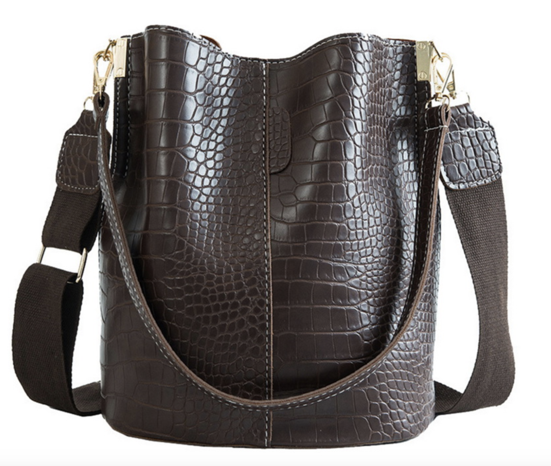 Accessory Concierge Faux Croc Tote ($65) - We're always checking out Accessory Concierge's huge assortment of baubles and bags and let's just say it's impossible to leave their Bluffview store empty-handed. This crocodile-inspired tote is just the right price *and* AC is also offering removable bag straps so you can totally change up the look.