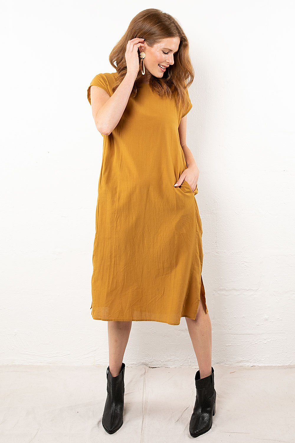 Favor The Kind Ochre Flowy Mini-Dress ($46) - This dress is perfectly foolproof. Gorgeous ochre shade, check. Edgy side slits, check. POCKETS, check. Wear it with a thick duster cardigan and printed ankle boots for a solid fall look.