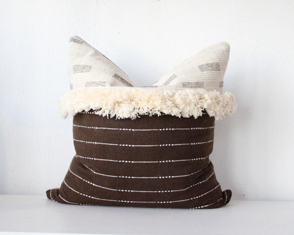 Magic Hour Vintage Textile Pillow ($75) - Nothing against those bright spring/summer textiles, but it's about time to switch things up a bit. This vintage fringed cushion from Oak Cliff's Magic Hour is a solid (and versatile) choice.