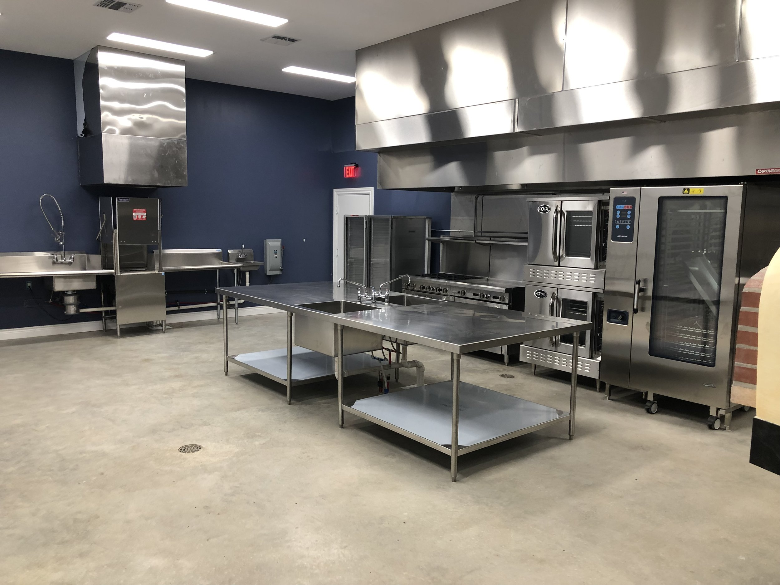 FarmResort Commercial Kitchen with Stoves and Dishwasher.jpg