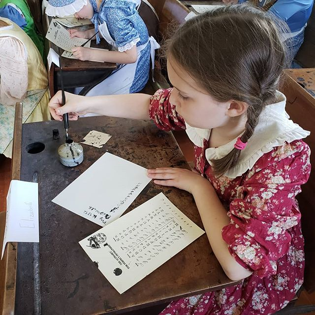Kids Discover the Trail! Tburg 4th Graders travel back to 1892 to have a day of instruction in the Eight Square Schoolhouse.