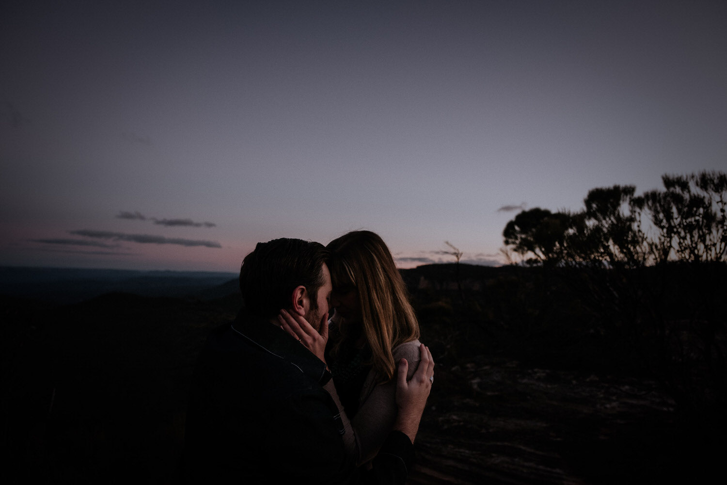 A couple take creative engagement photos before their wedding in the Blue Mountains