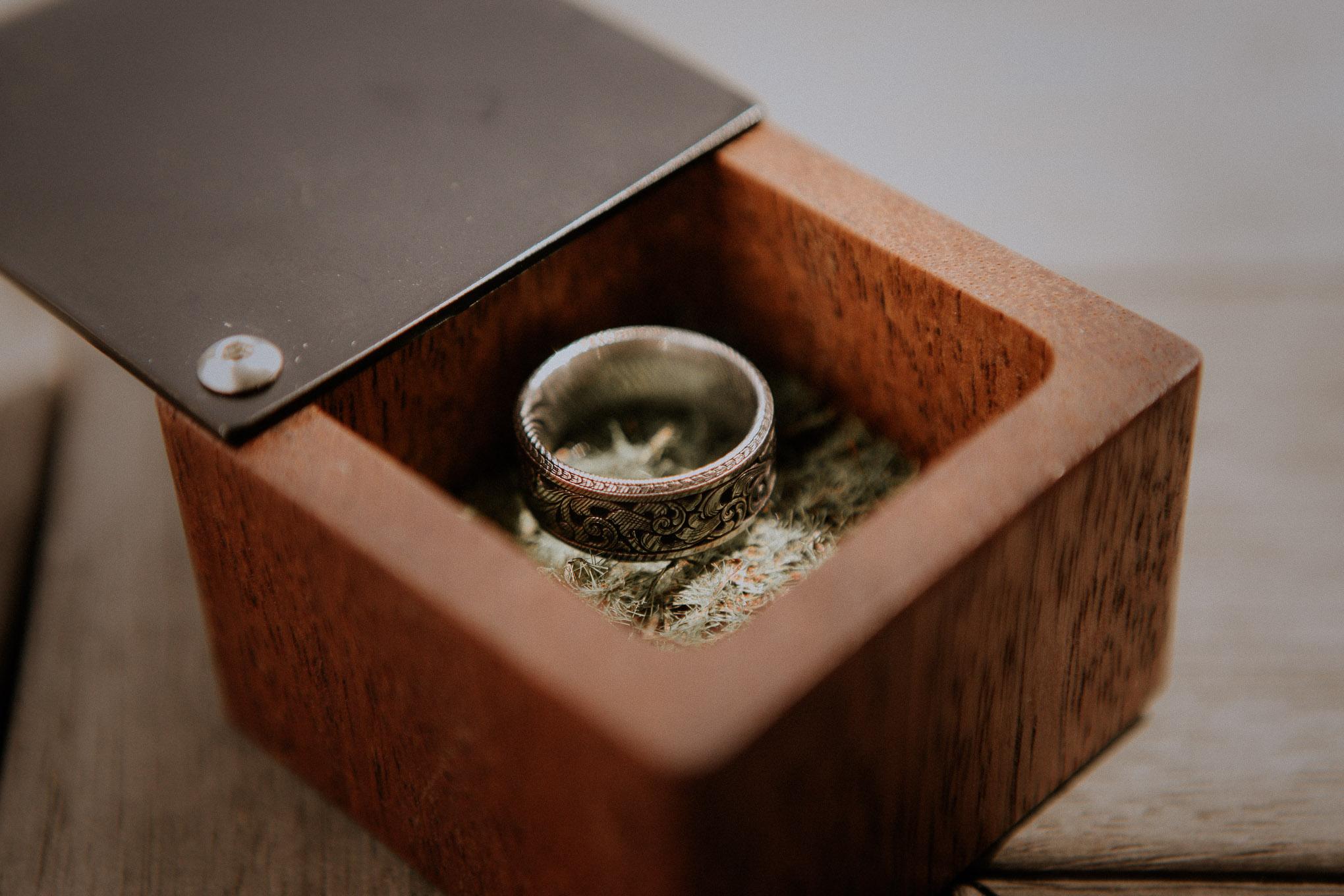 Groom's wedding ring in a custom timber box