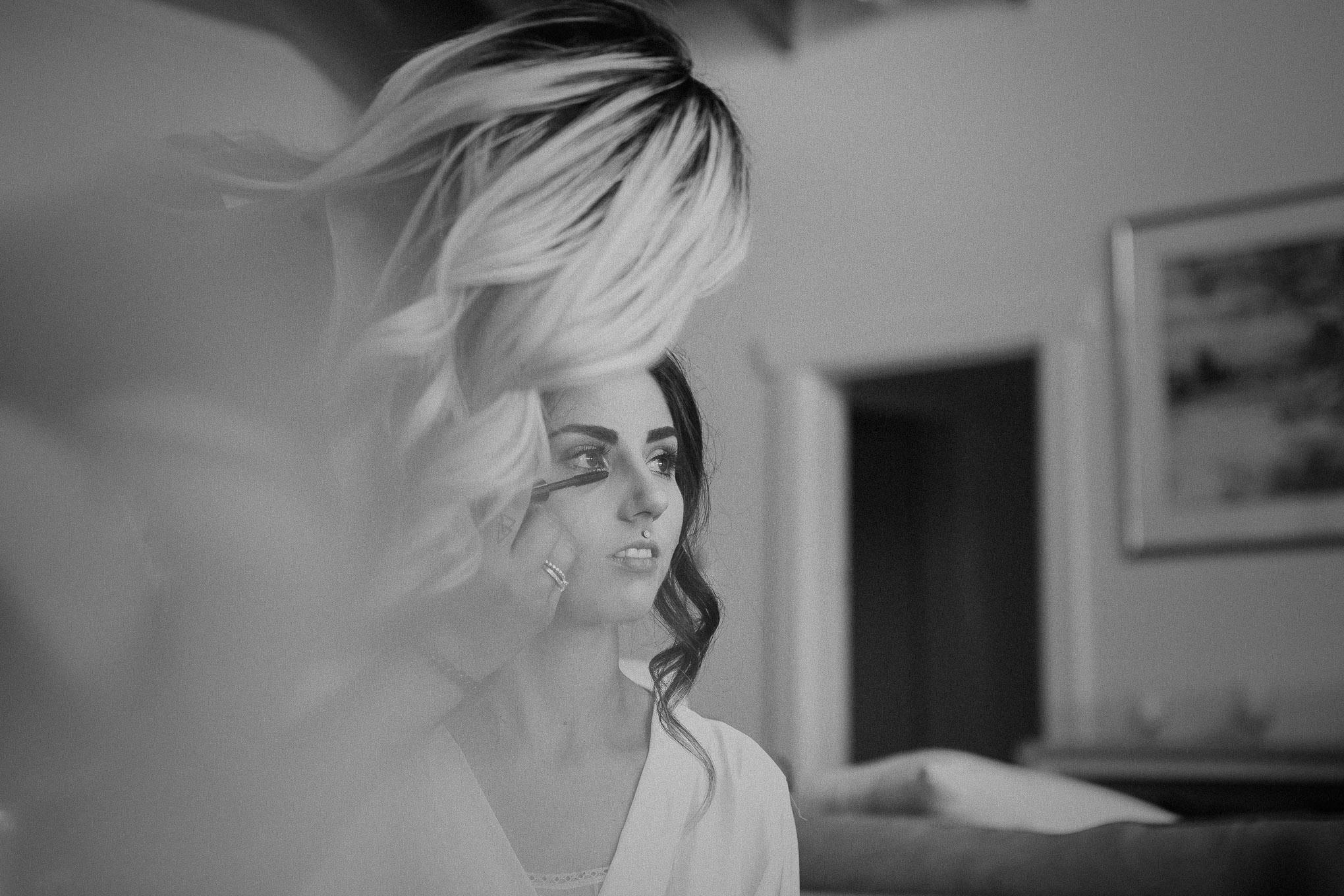 Bride having her makeup done before her wedding