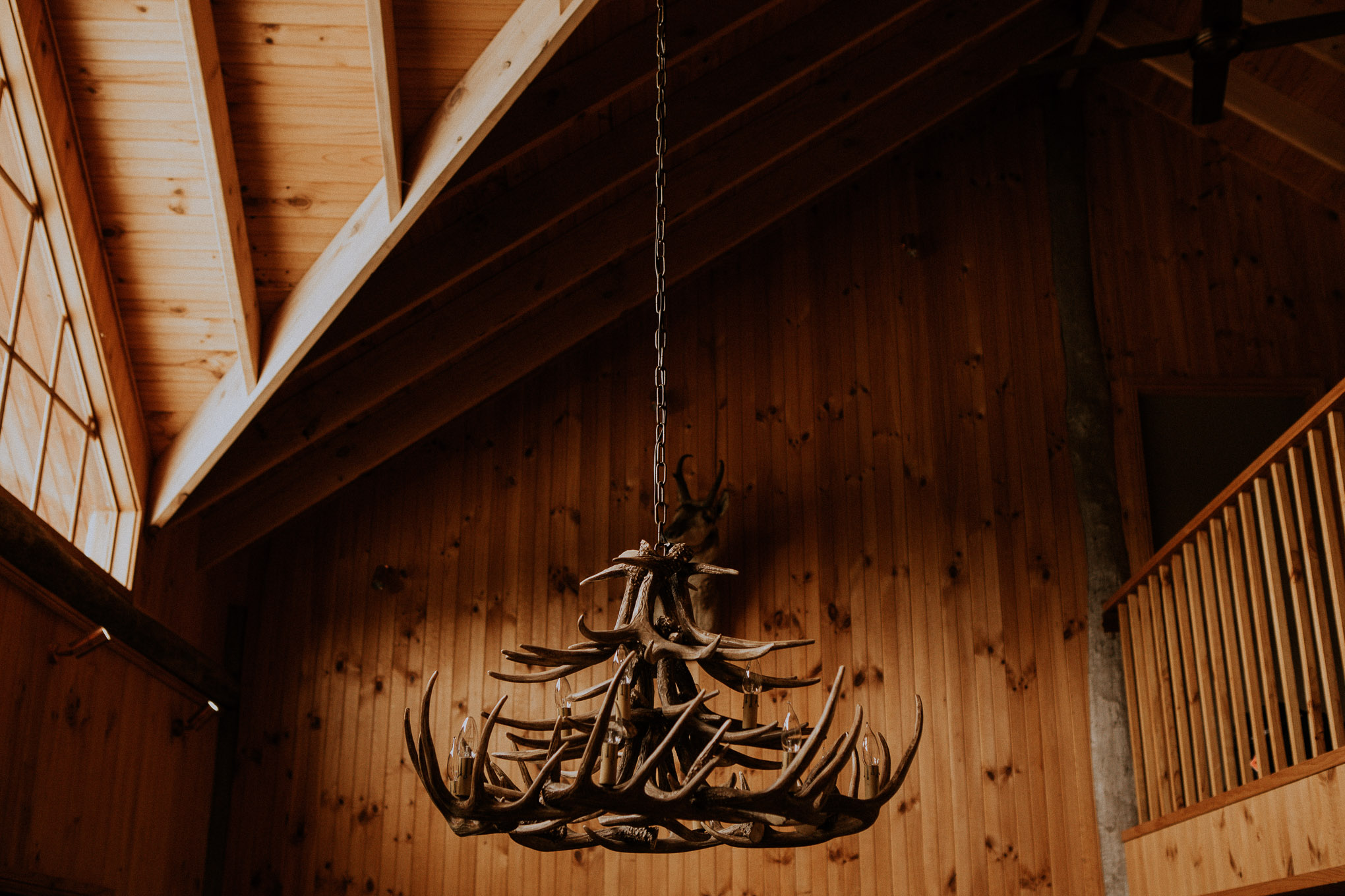 Wooden antler chandelier in timber cabin at Waldara Farm Wedding Venue