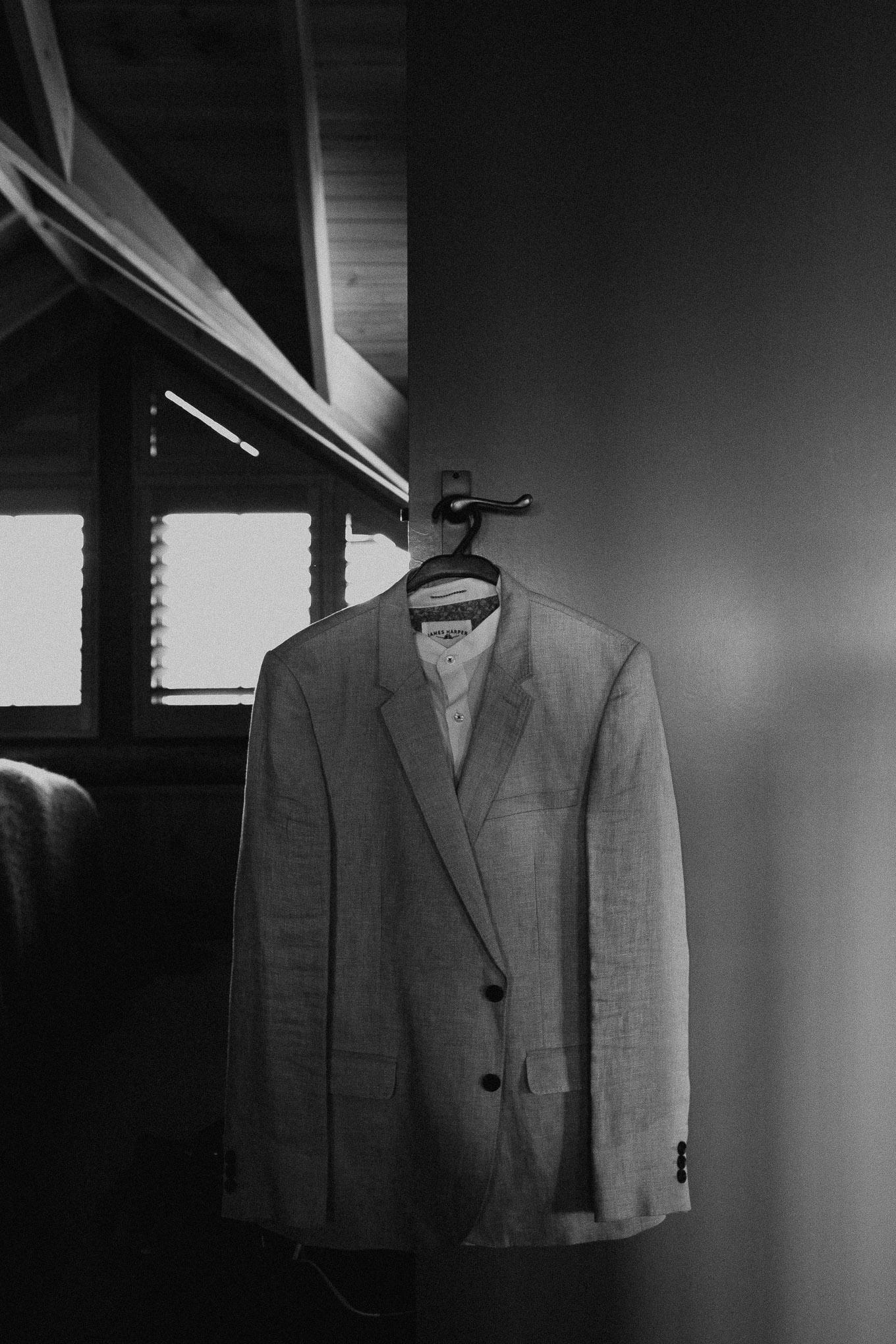 Groom's suit hanging on a door