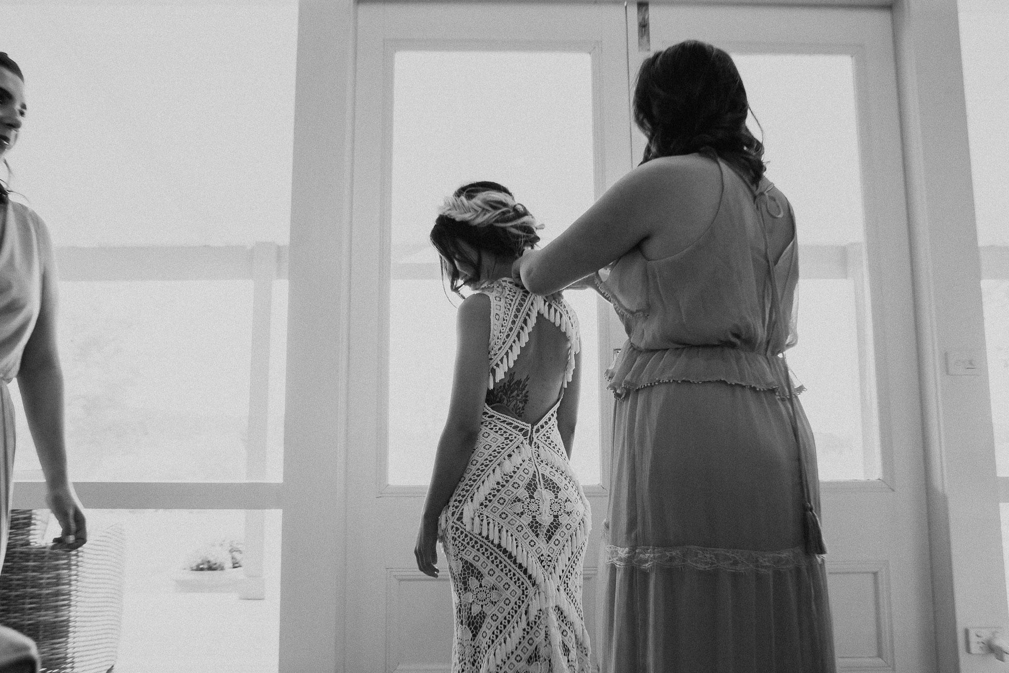 Bridesmaids helping bride getting ready