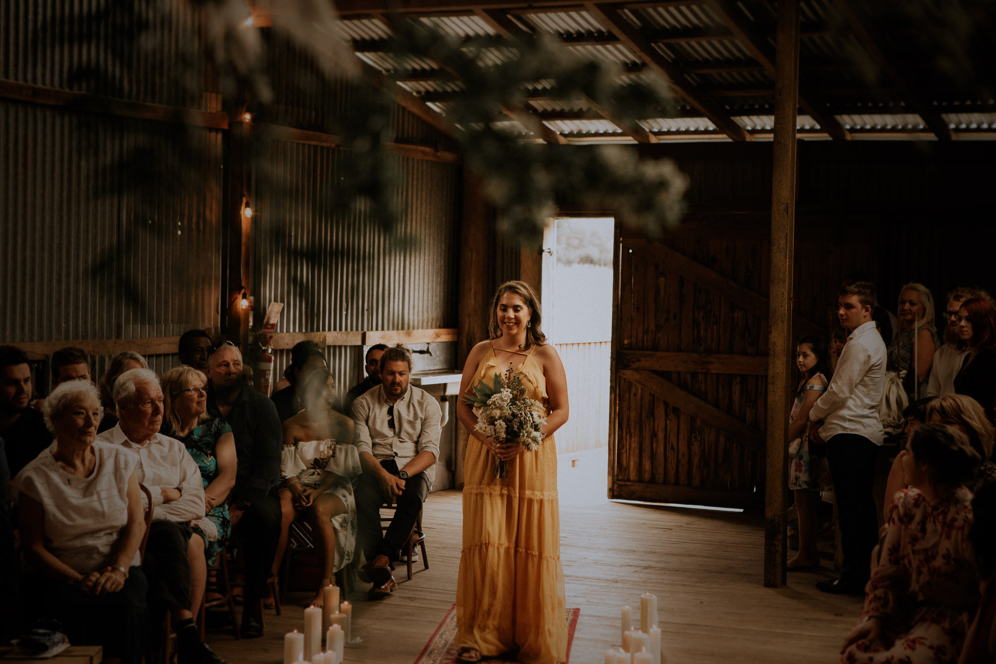 A rustic and heartfelt wedding ceremony in boho chic shearing shed at Waldara Farm