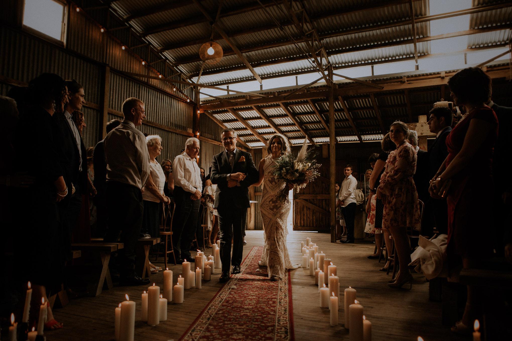 Bride walks down the aisle at a rustic wedding ceremony at Waldara Farm