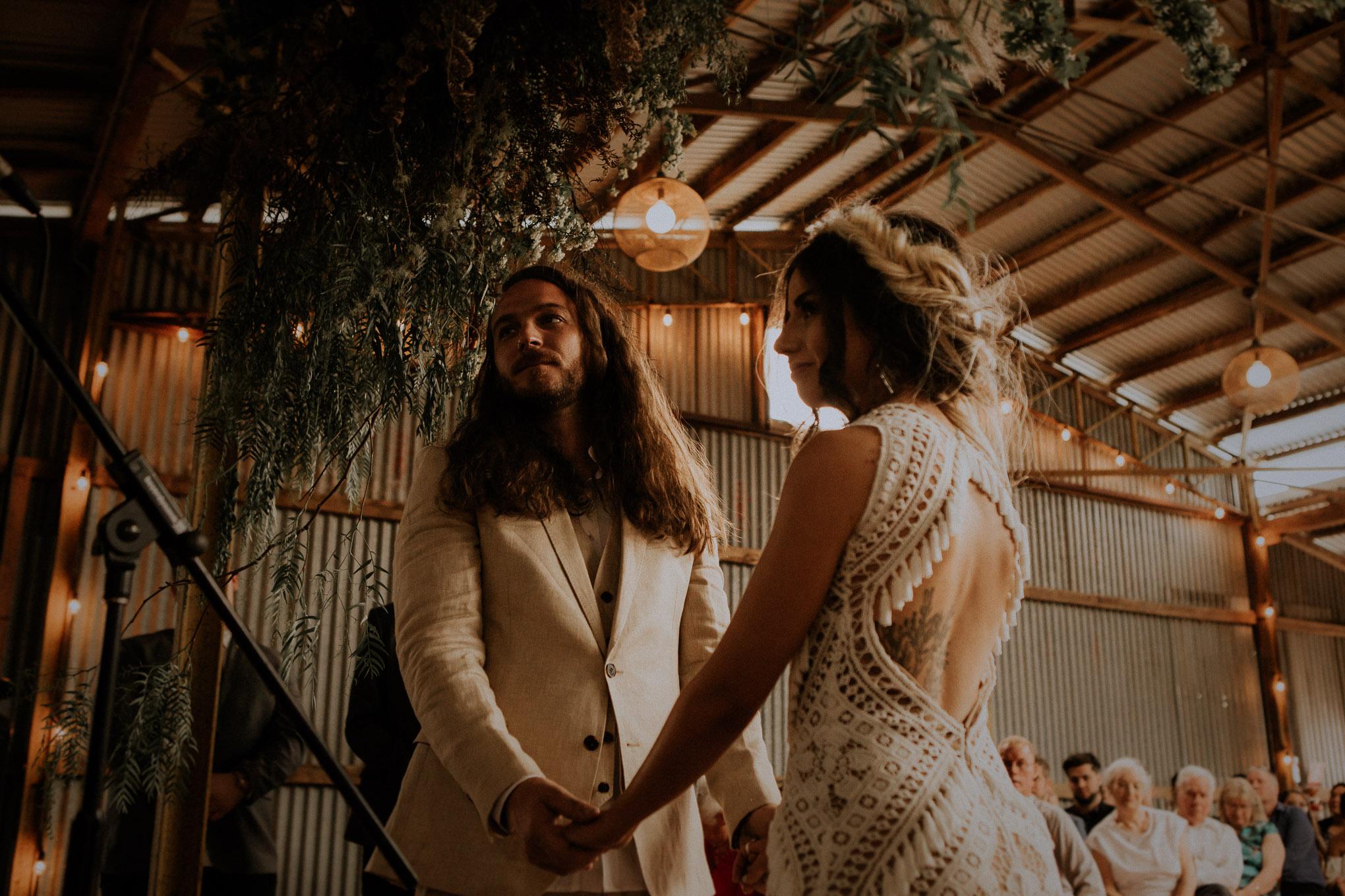 Boho chic wedding ceremony in a rustic shearing shed at Waldara Farm