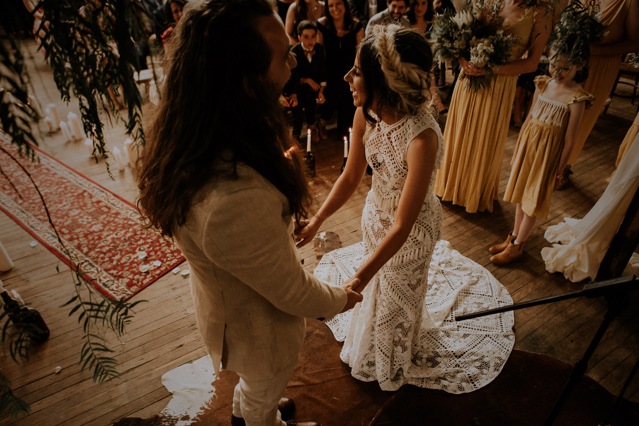 Laughter during boho chic wedding ceremony in a rustic shearing shed at Waldara Farm