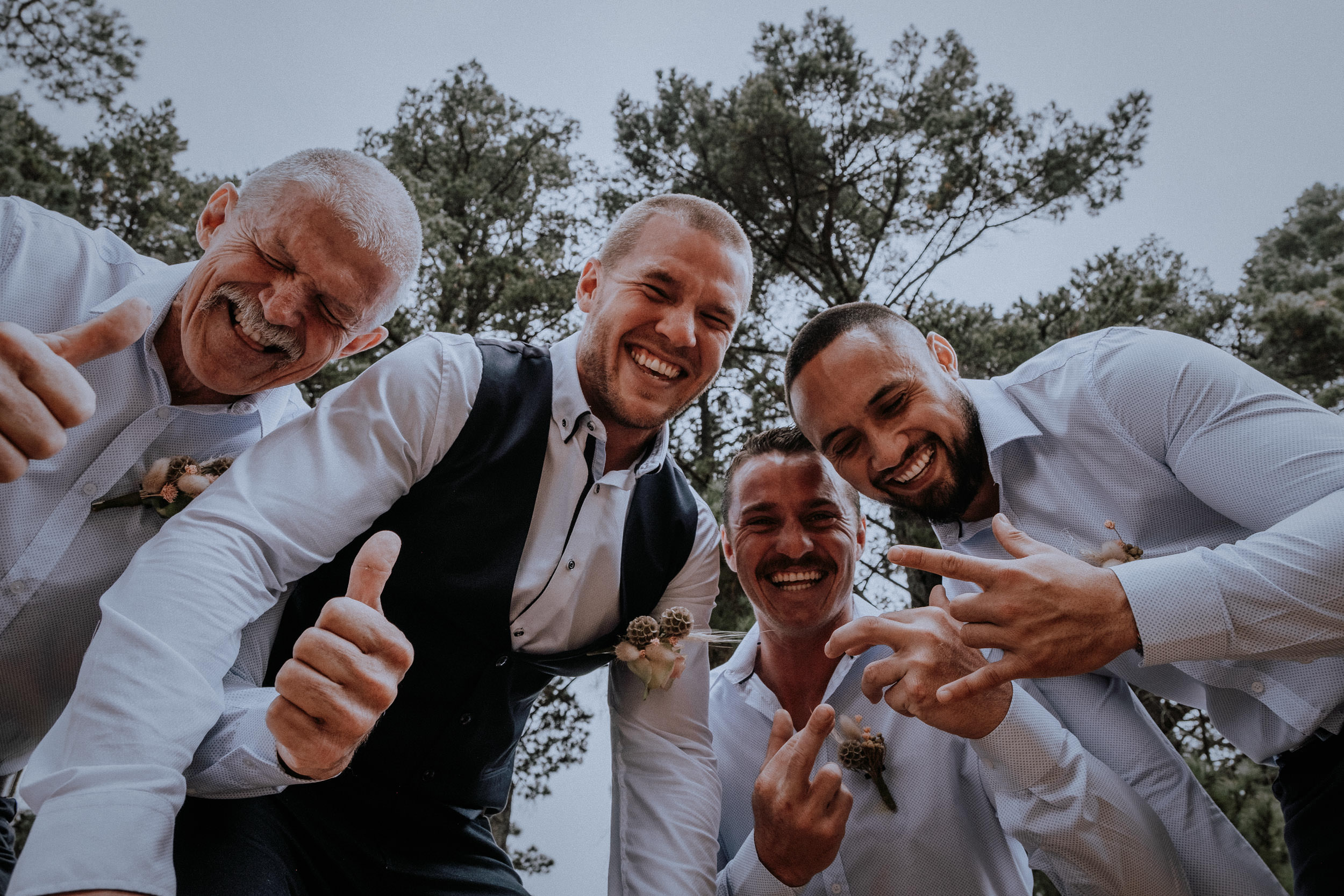 Fun groom and groomsmen portraits outside by the pine forest at Seclusions Blue Mountains
