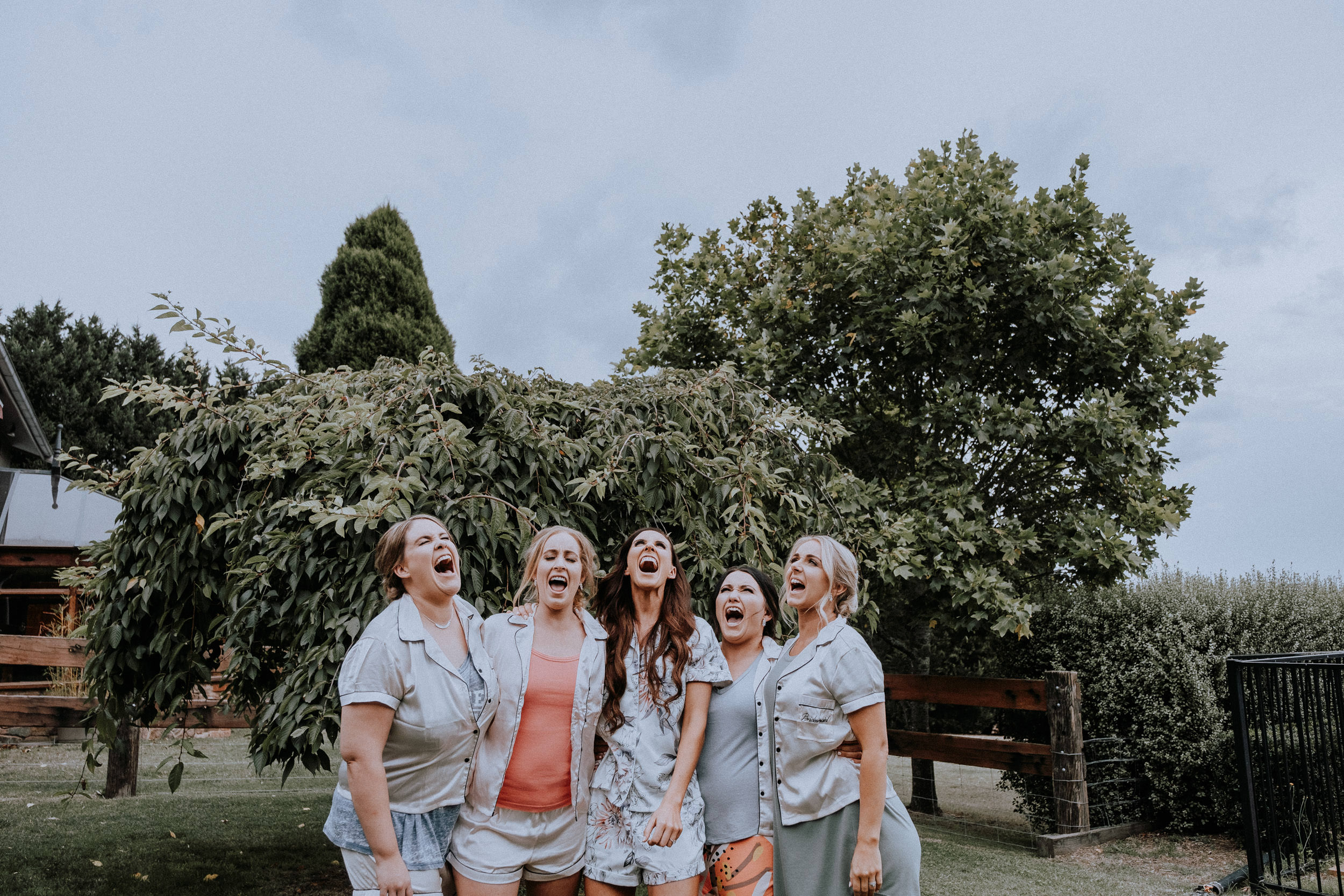 Fun group portraits of a bride and her bridesmaids outside at Seclusions Blue Mountains