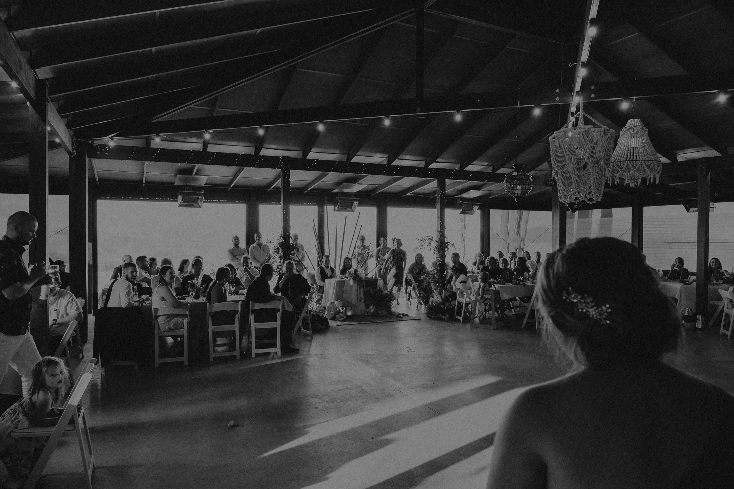 Bride, groom and guests enjoy the wedding reception in the Pavilion at Seclusions Blue Mountains