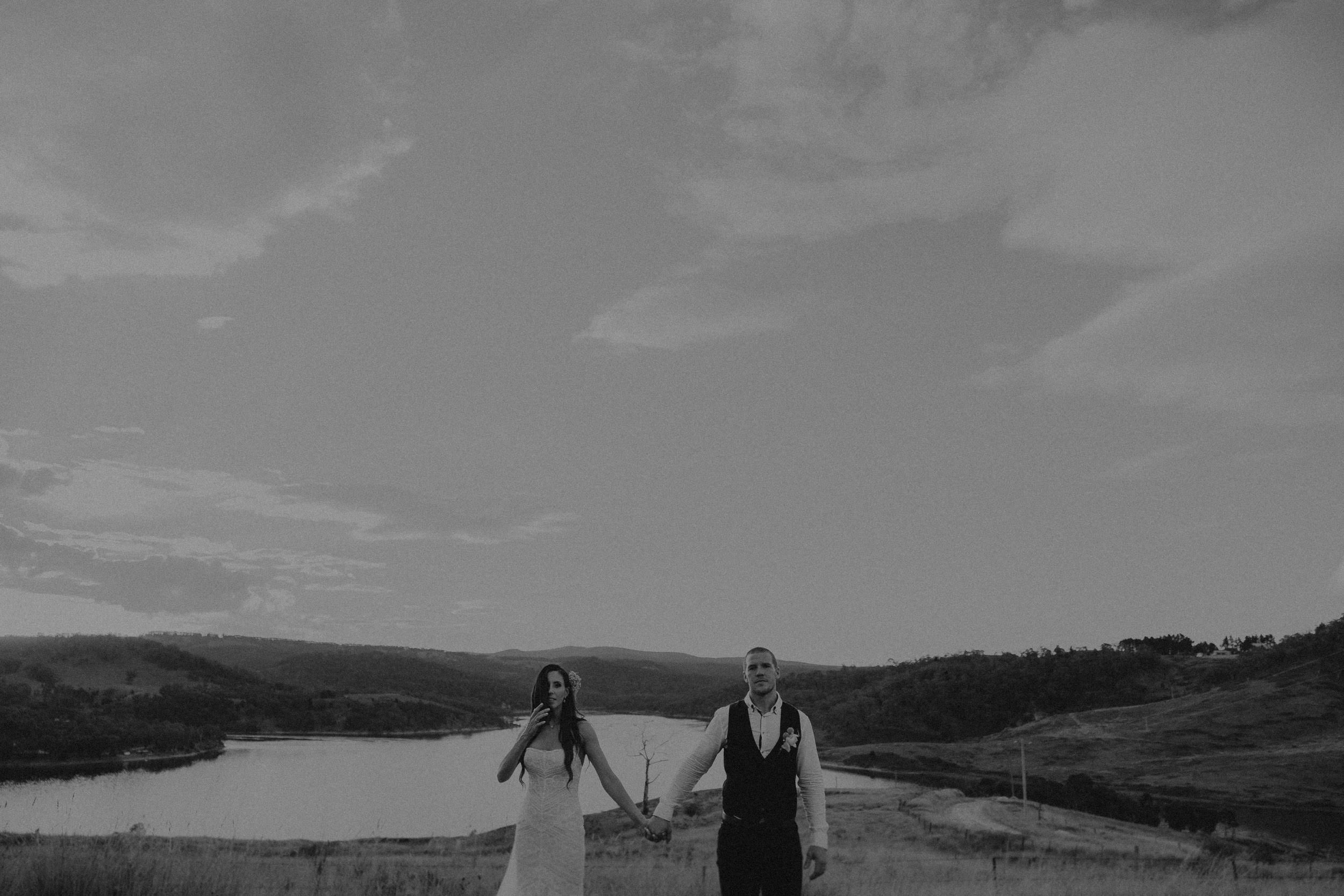 Bride and groom having sunset portraits for their wedding by Lake Lyell, Lithgow