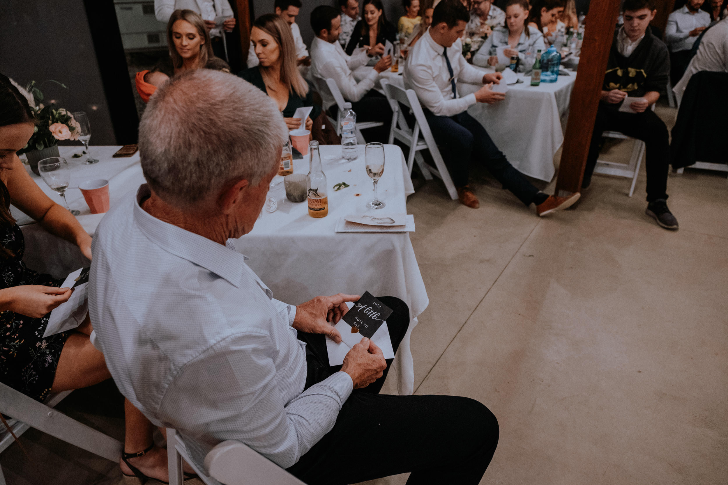 Bride and groom's speeches and surprise pregnancy announcement during wedding reception at Seclusions, captured by Kings & Thieves Blue Mountains Wedding Photography