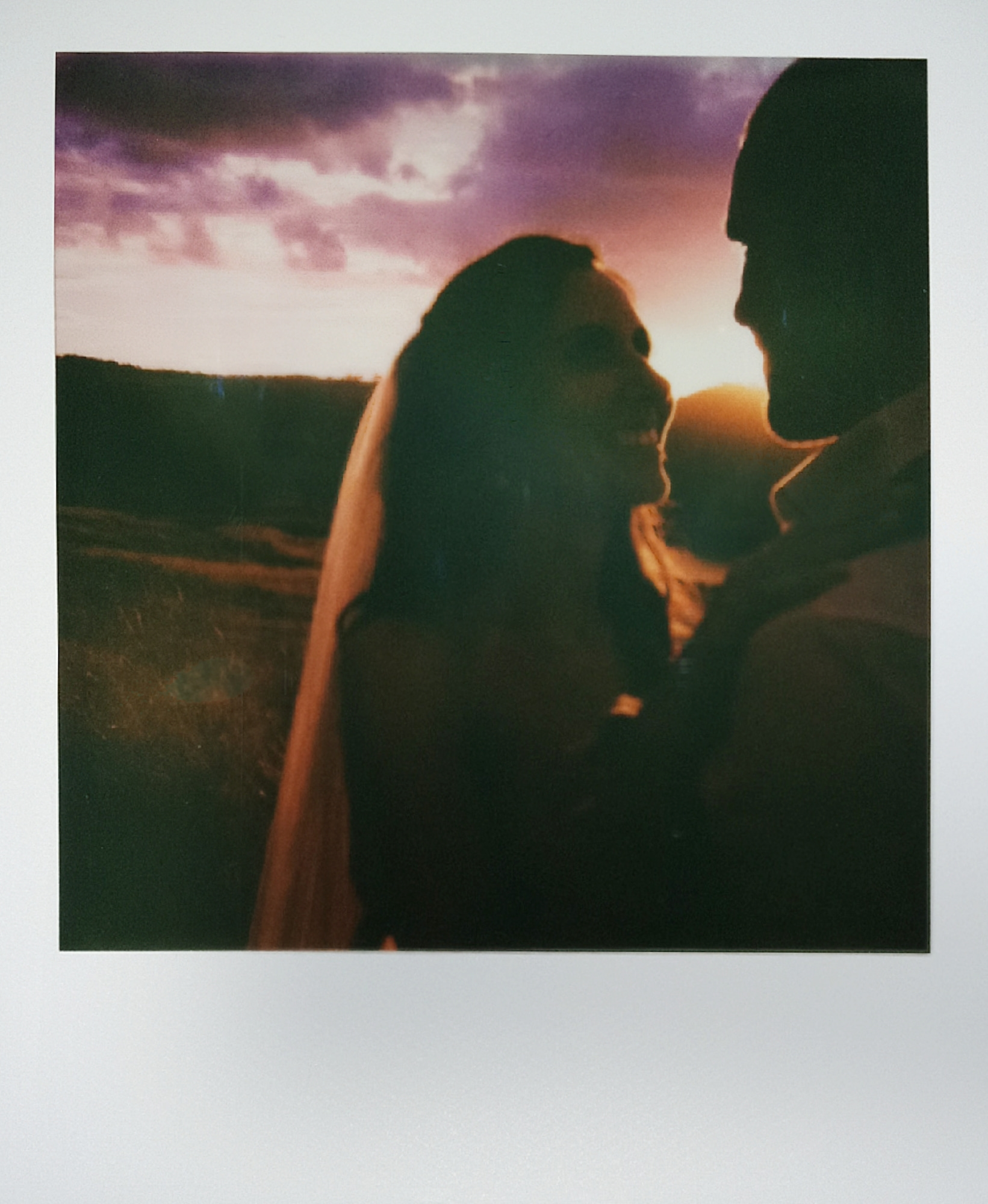 Polaroid frames of a bride and groom during sunset by Lake Lyell