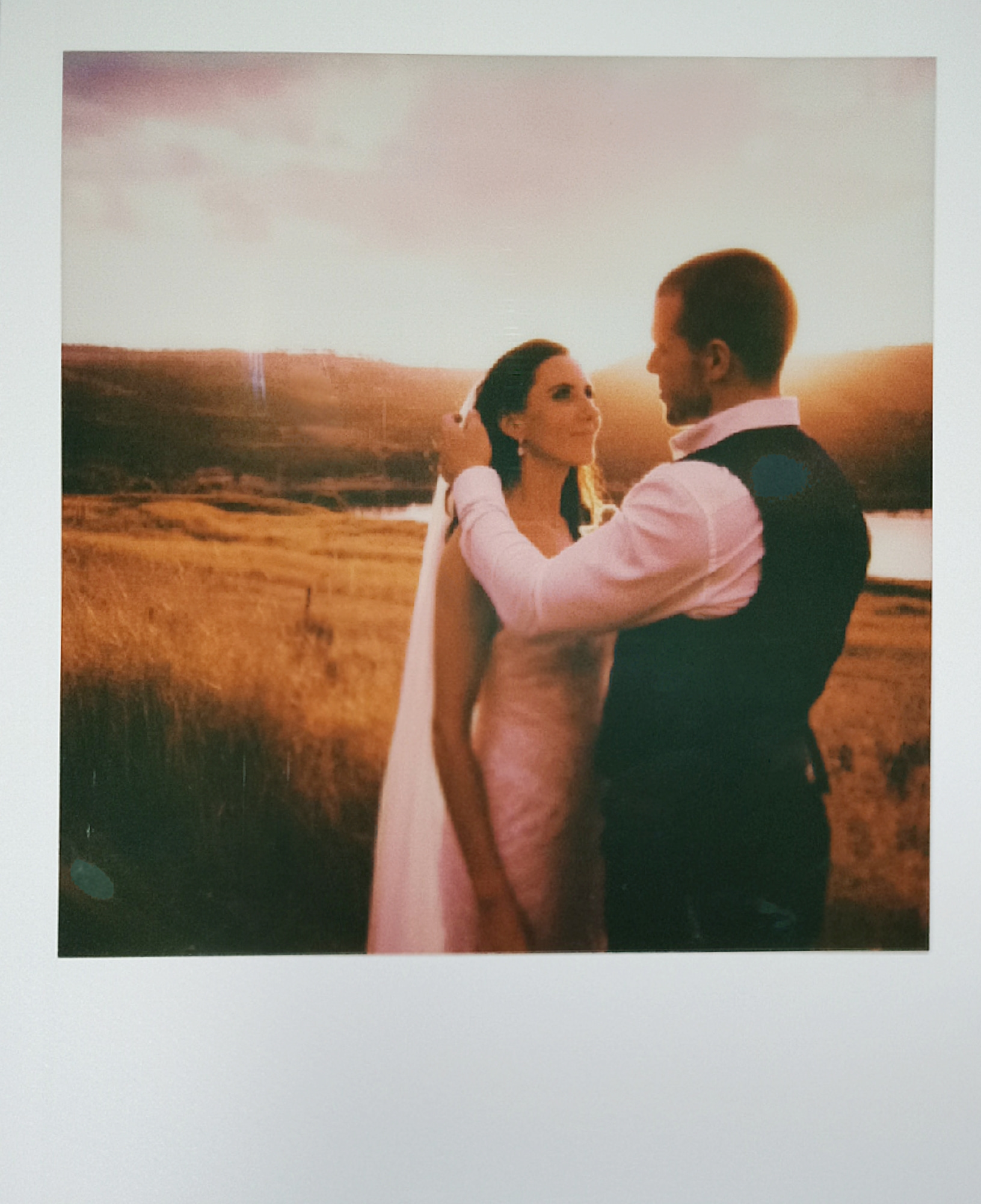 Polaroid frames of bride and groom at sunset by Lake Lyell