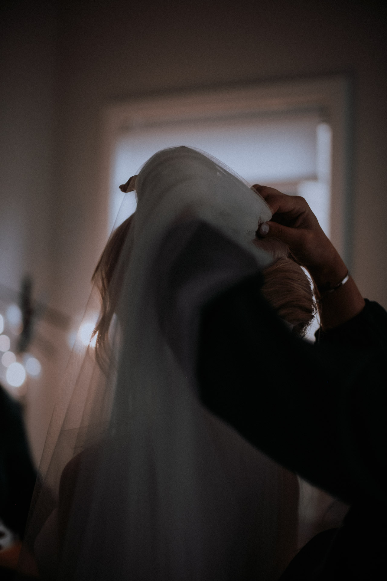 A bride having her veil fitted