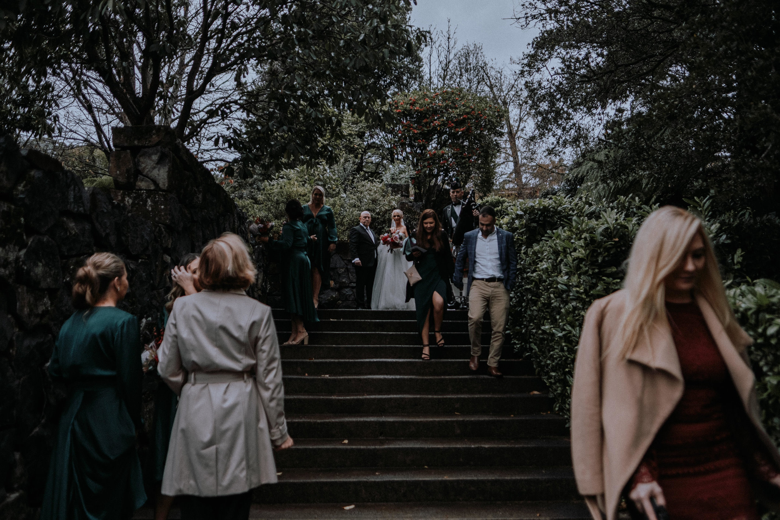 A bride about to walk down the aisle with her father on concrete steps at Mt Tomah Botanic Garden