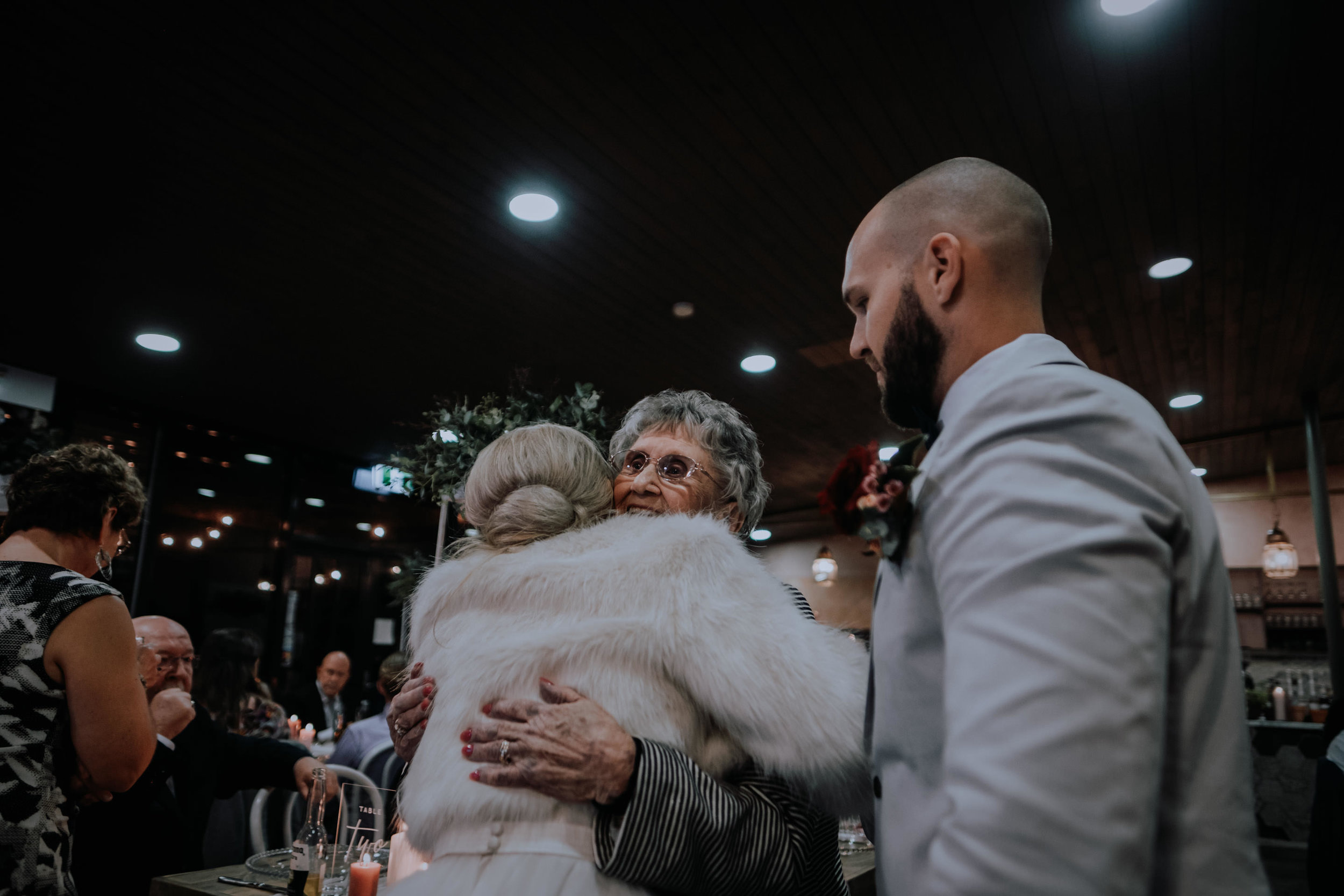 An emotional reunion with a bride and grandma at the wedding reception
