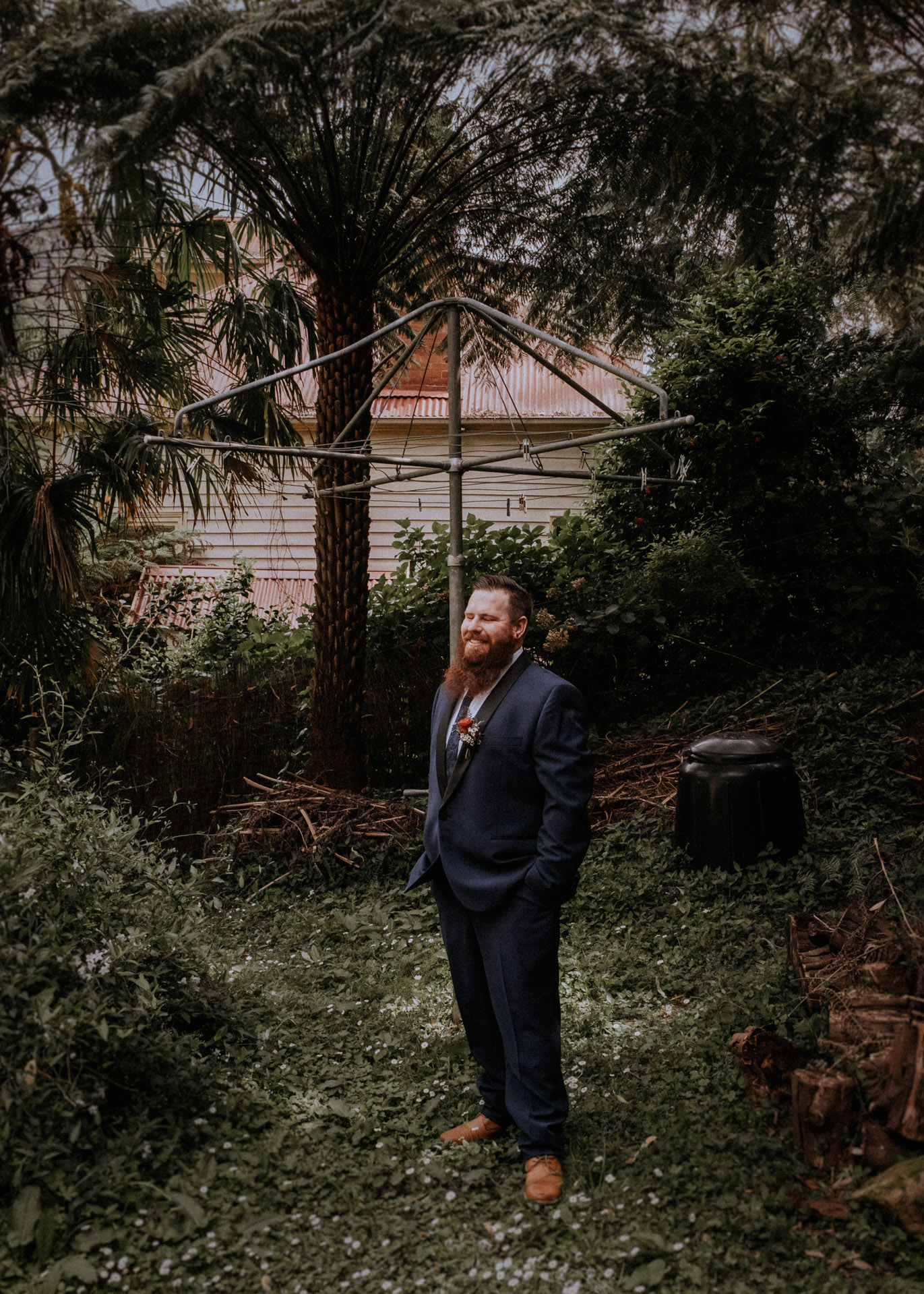 A portrait of a groom getting ready for his Redwood Forest wedding in Melbourne
