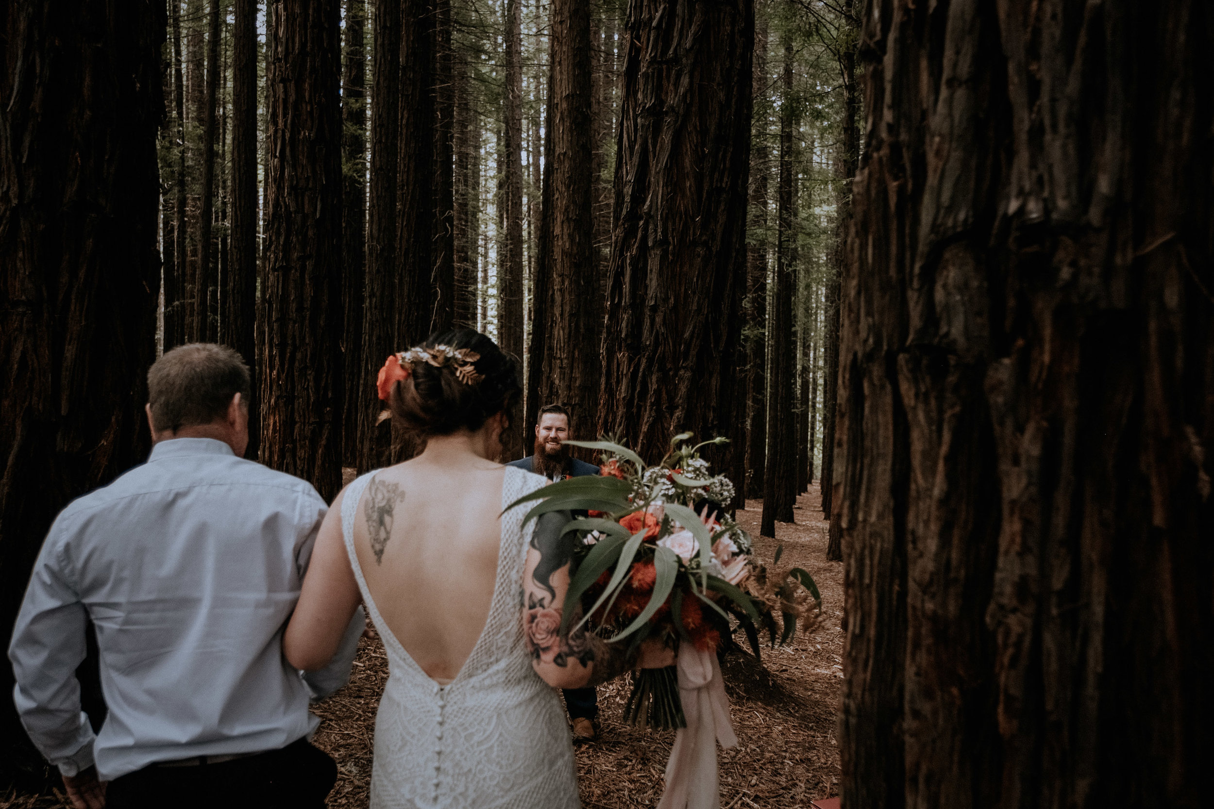 A groom sees his bride for the first time at their small wedding, candidly captured with intimate vibes, in the Redwood Forest in Warburton, near Melbourne