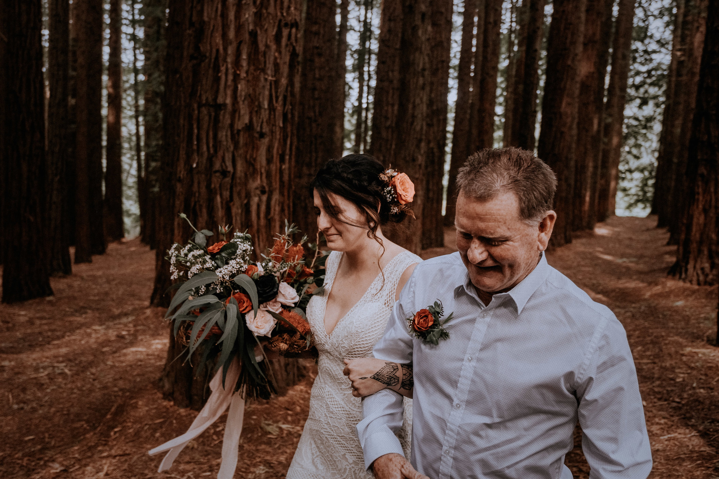 A bride arrives to her small wedding, candidly captured with intimate vibes, in the Redwood Forest in Warburton, near Melbourne