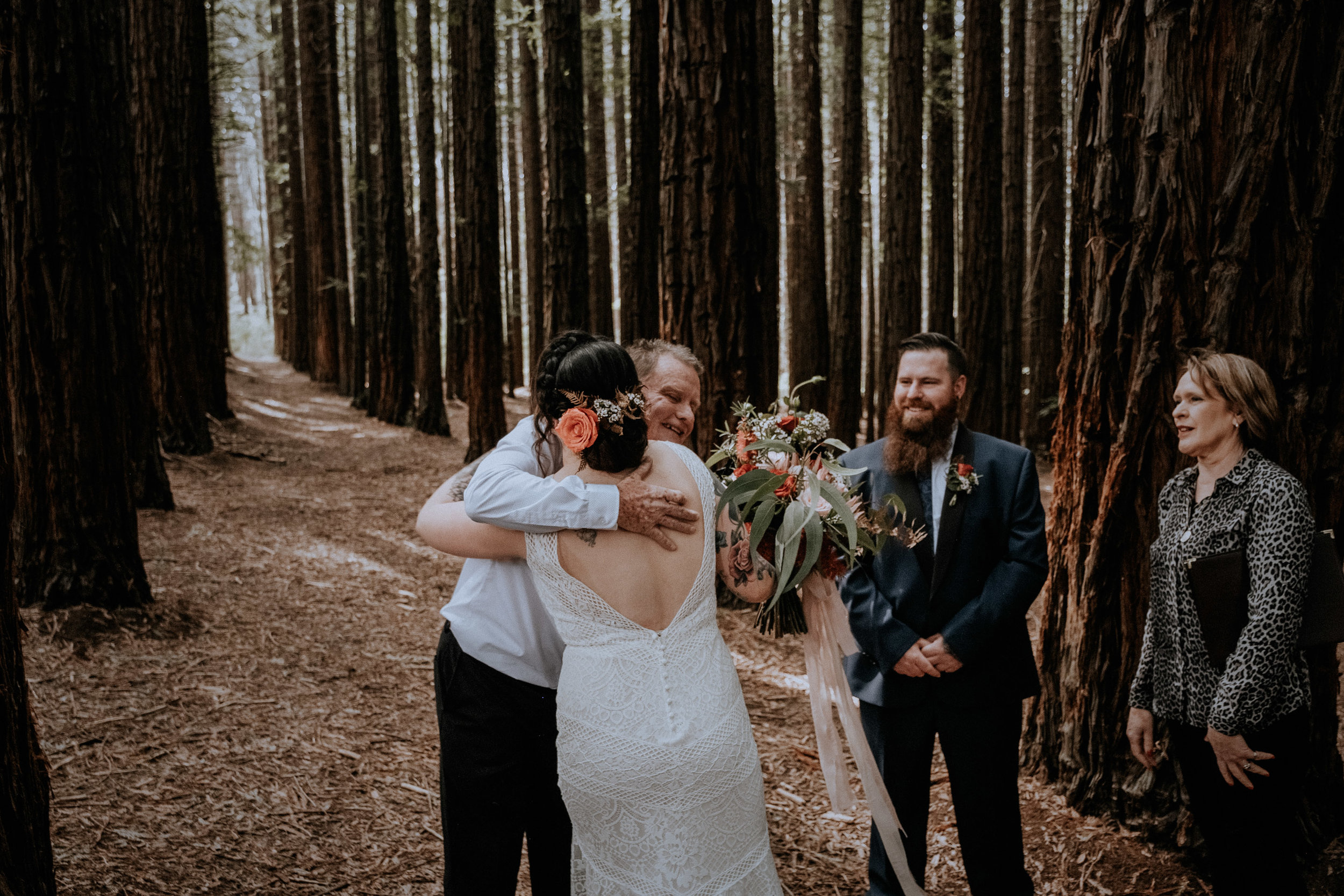 A dad giving away the bride at her small wedding, candidly captured with intimate vibes, in the Redwood Forest in Warburton, near Melbourne