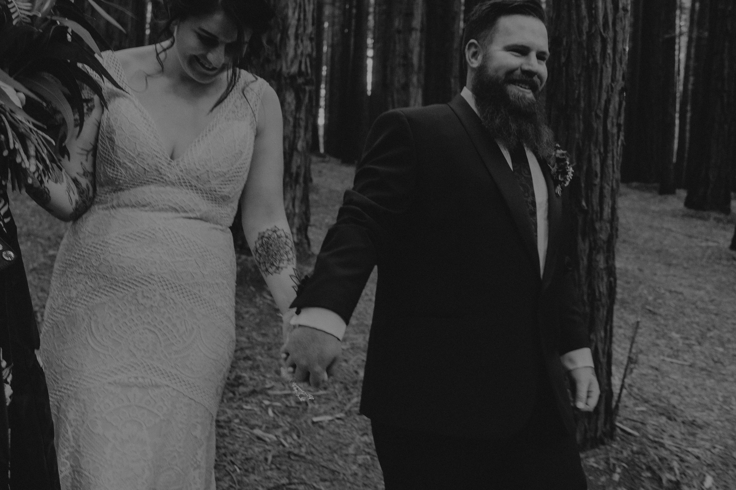 A bride and groom have their portraits taken, candidly captured with intimate vibes, in the Redwood Forest in Warburton, near Melbourne