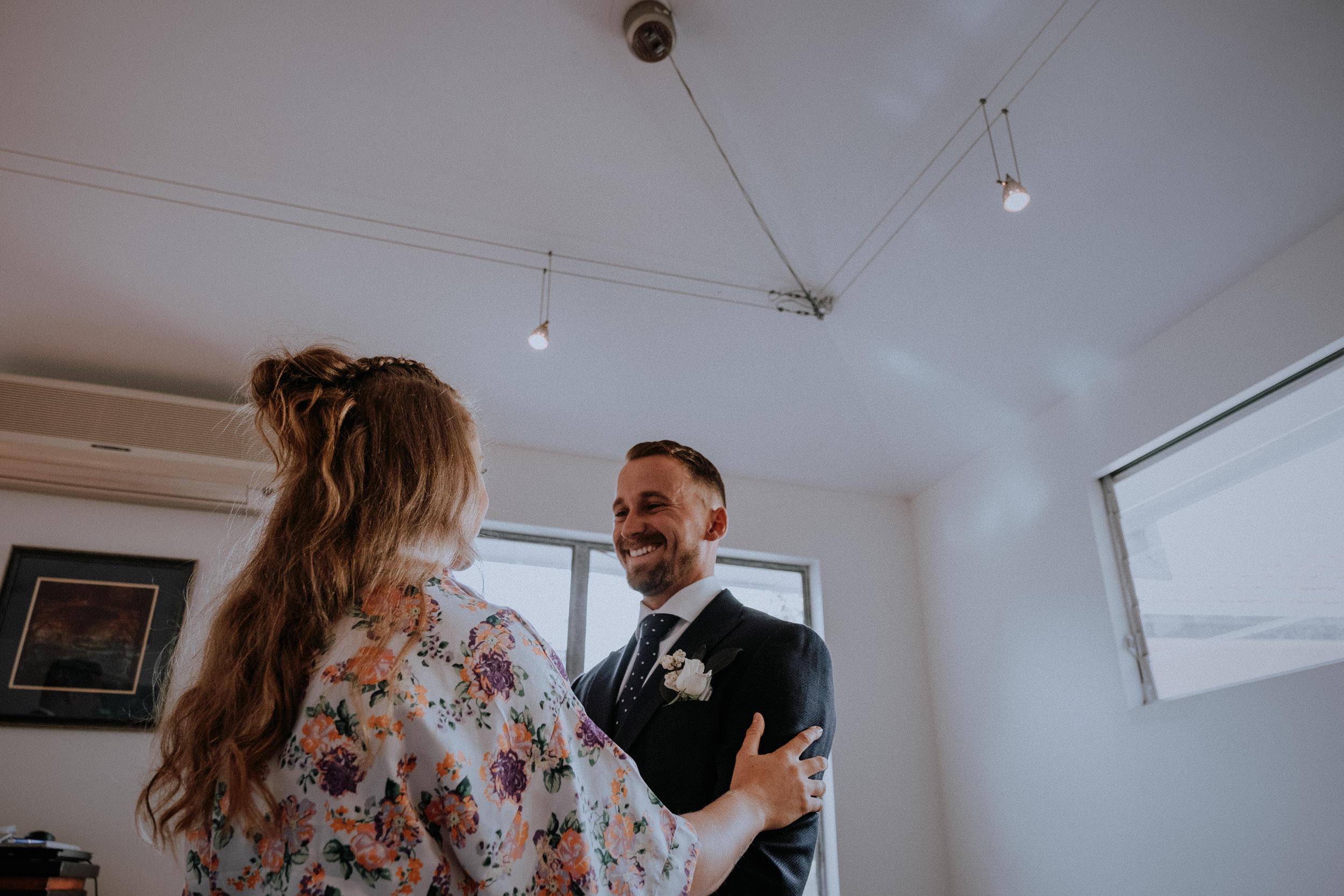 Groom shares a laugh with his sister before his Sydney Airbnb backyard wedding