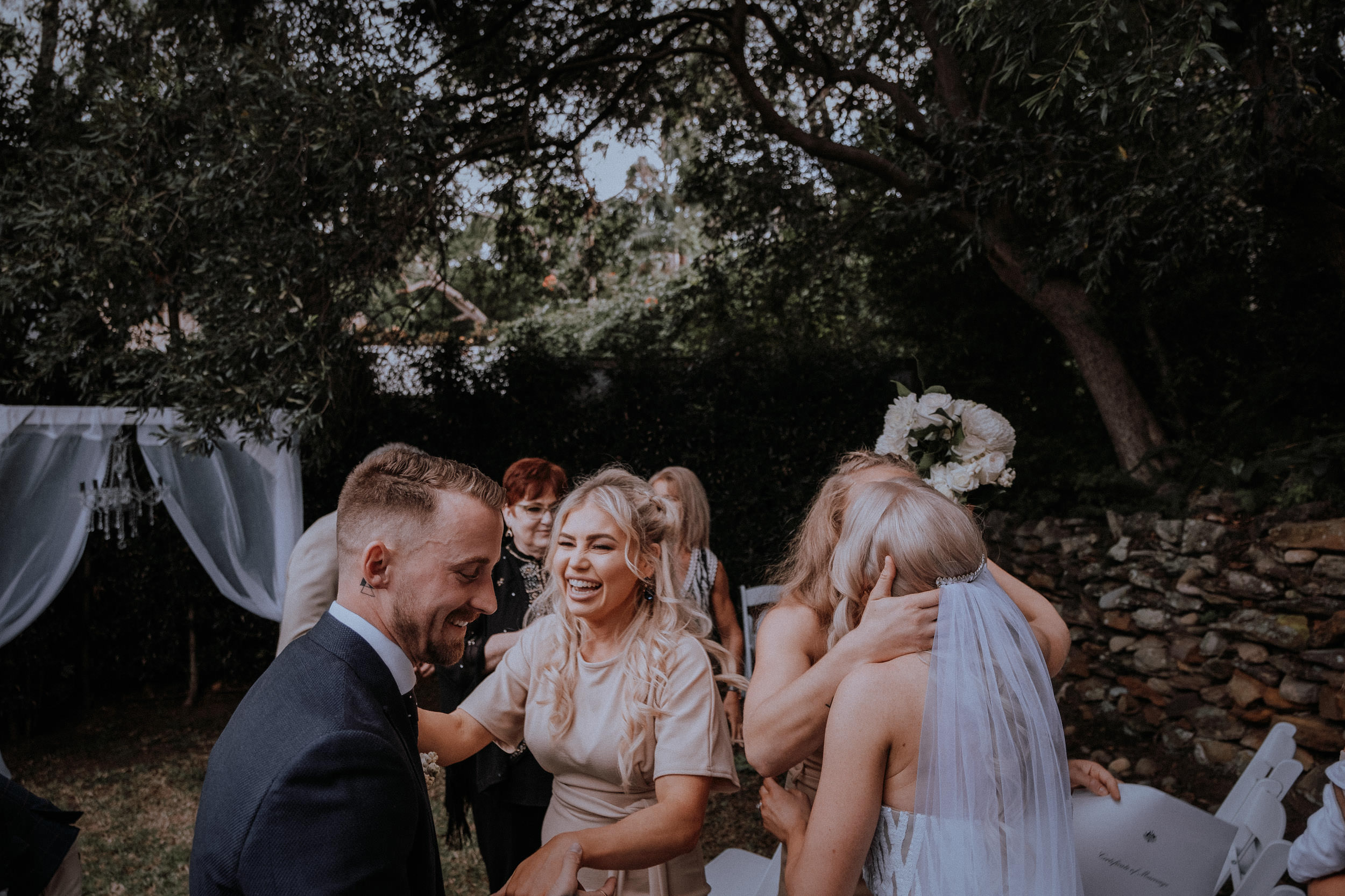 Wedding guests enjoying their time in laughter during the surprise Sydney Airbnb backyard wedding