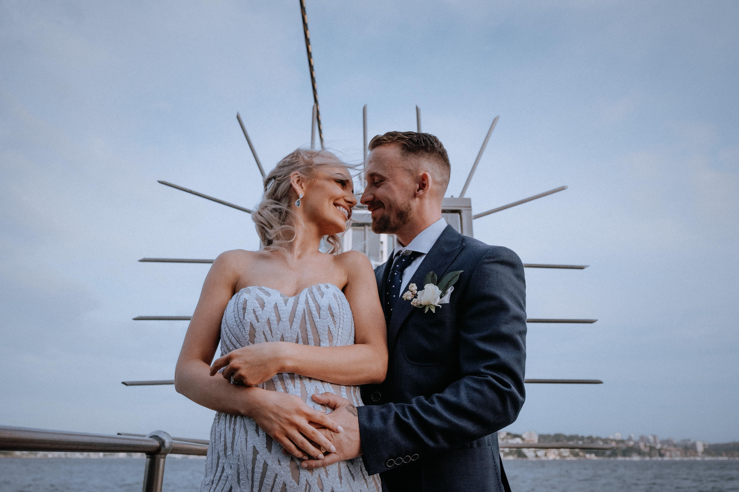 A newly married bride and groom by the lighthouse at Bradley's Head, by Sydney Harbour, at sunset