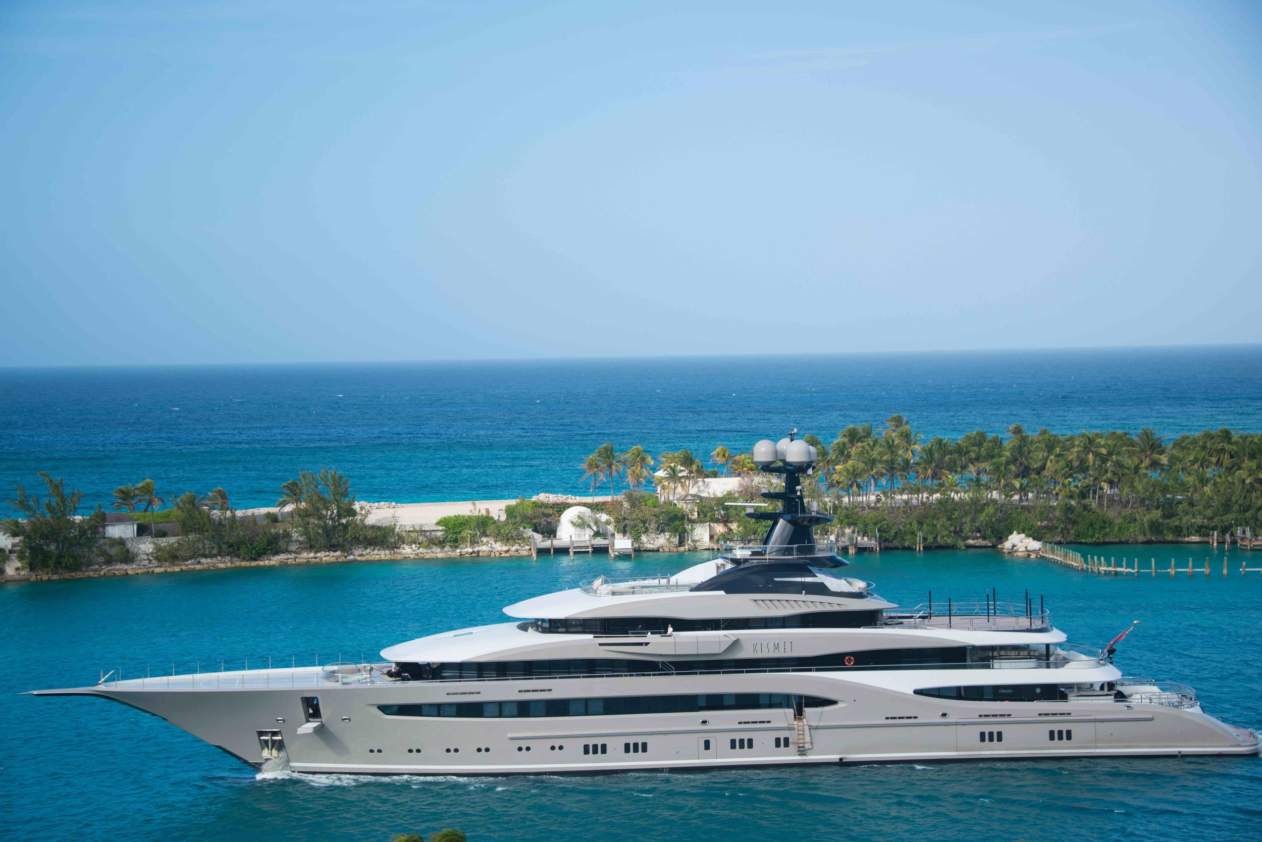 A Superyacht with a helicopter on the fore deck, a classic example of the need for risk assessment and contingency planning