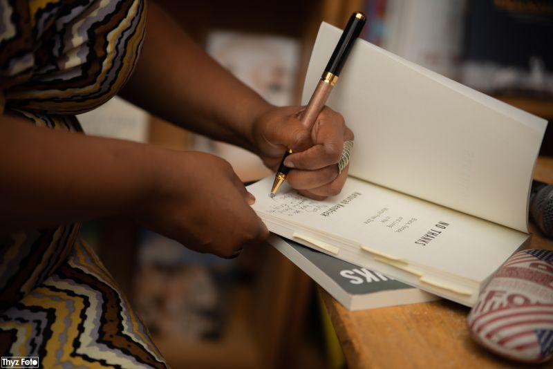 closeup signing book.jpg
