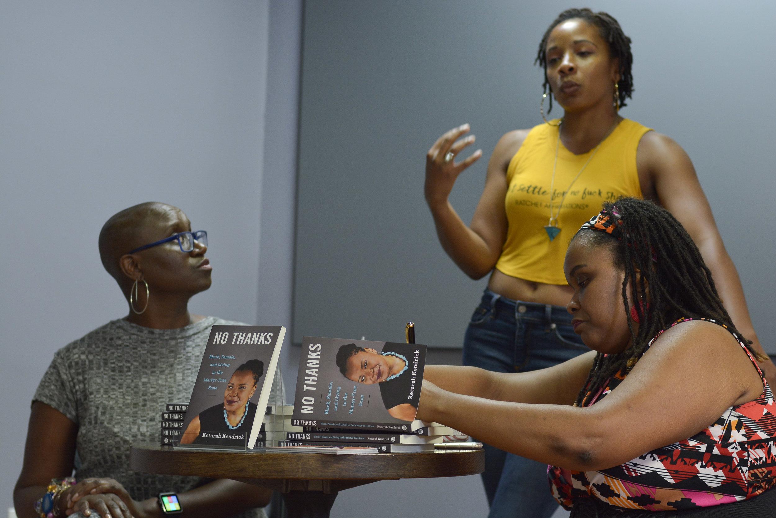 signing jamilah's book.jpg