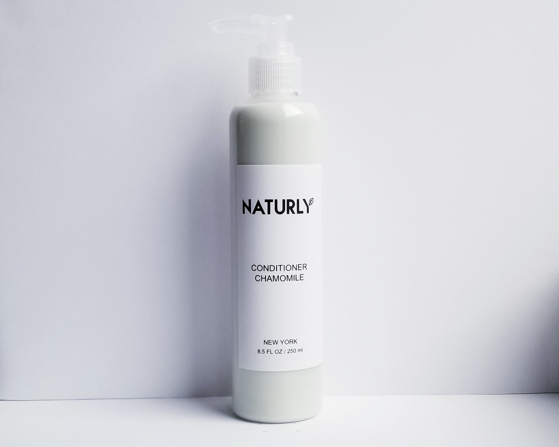 Conditioner with coconut emollient, chamomile & lavendar oils, anti-oxidant chlorophyl extract - $24
