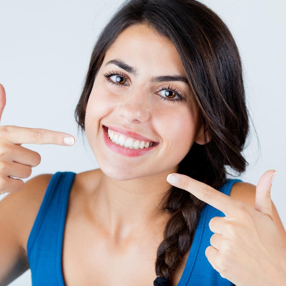 adult teeth straightening lady happy after cosmetic treatment biddulph