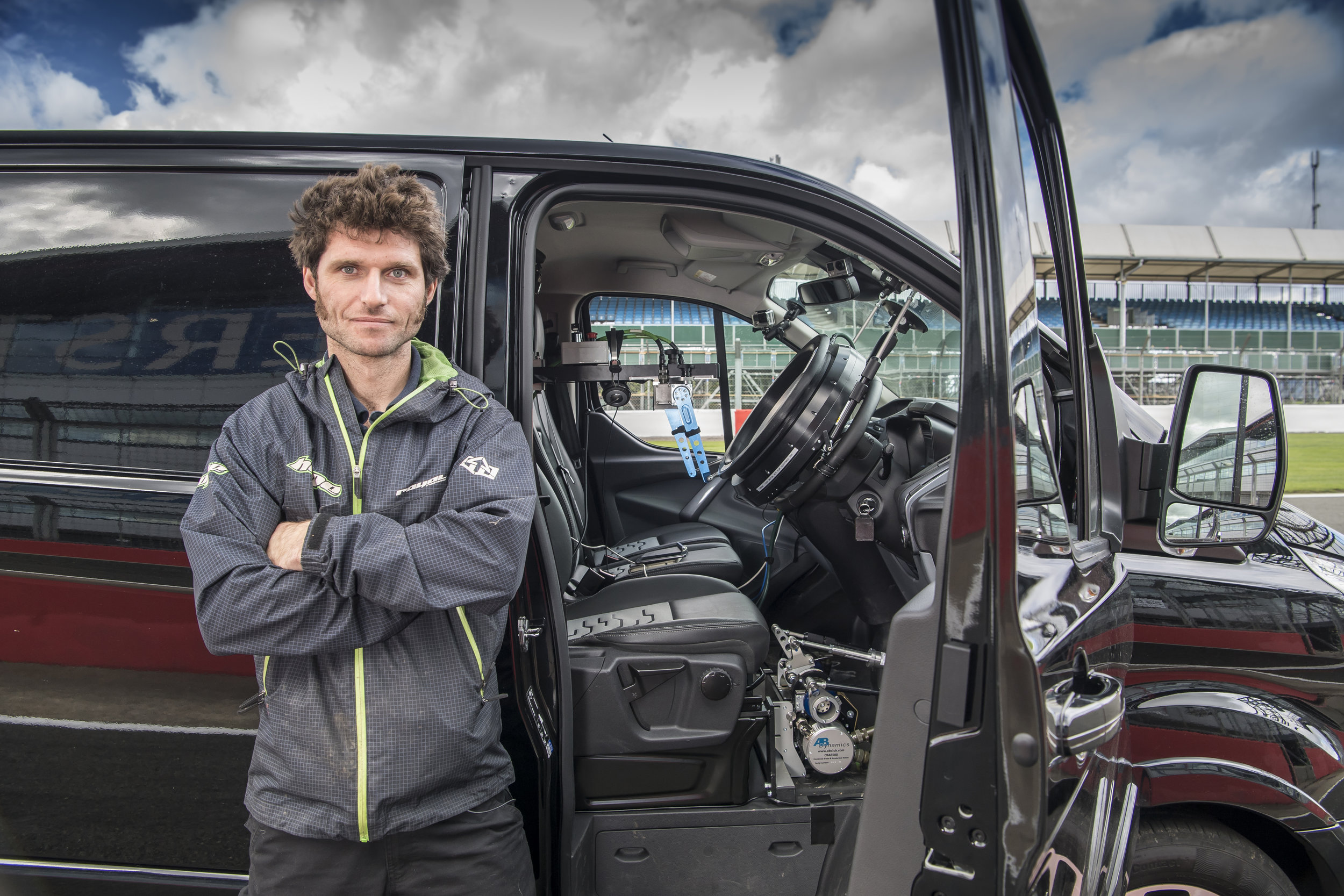 GuyMartinVsTheRobotCar Guy CU by side of Transit fitted with AB Dynamic gear at Silverstone Circuit 130917©BarryHayden.jpg