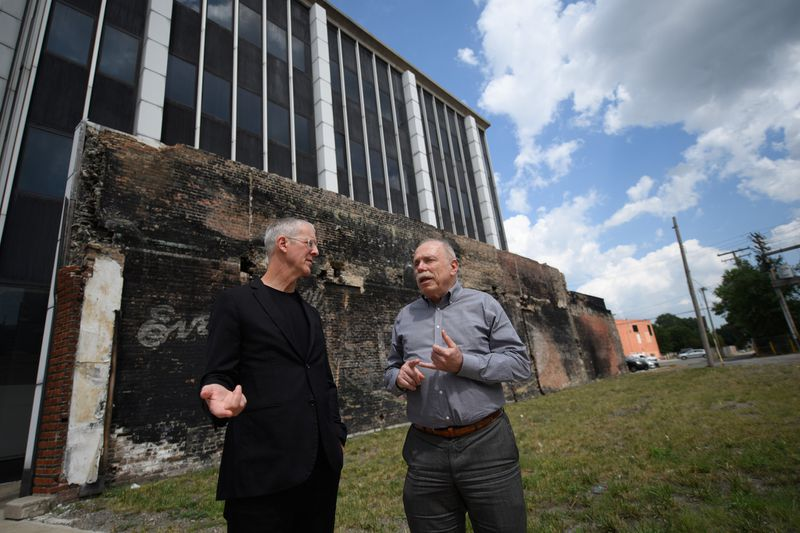 City planner Jeff Speck, left, and David D. Dixon, vice president and director of Stantec Urban Places, speak about their plans for Hammond's downtown on Aug. 8, 2019. (Kyle Telechan / Post-Tribune)