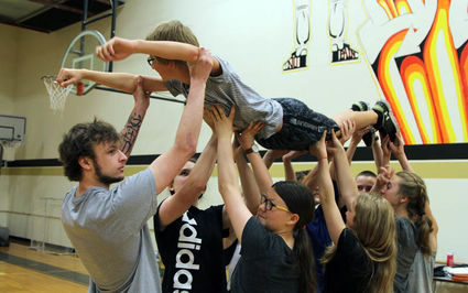 "STUDENTS PARTICIPATE IN A PHLIGHT CLUB RETREAT AT SEELEY LAKE ELEMENTARY ON MAY 22 BY LIFTING THEIR CLASSMATE WYATT STOUT IN AN ACTIVITY MEANT TO DEMONSTRATE THAT STUDENTS CAN ONLY ""FLY"" WHEN THEY ARE SUPPORTED BY OTHERS. - PHOTO BY ZOIE KOOSTRA, PATHFINDER"