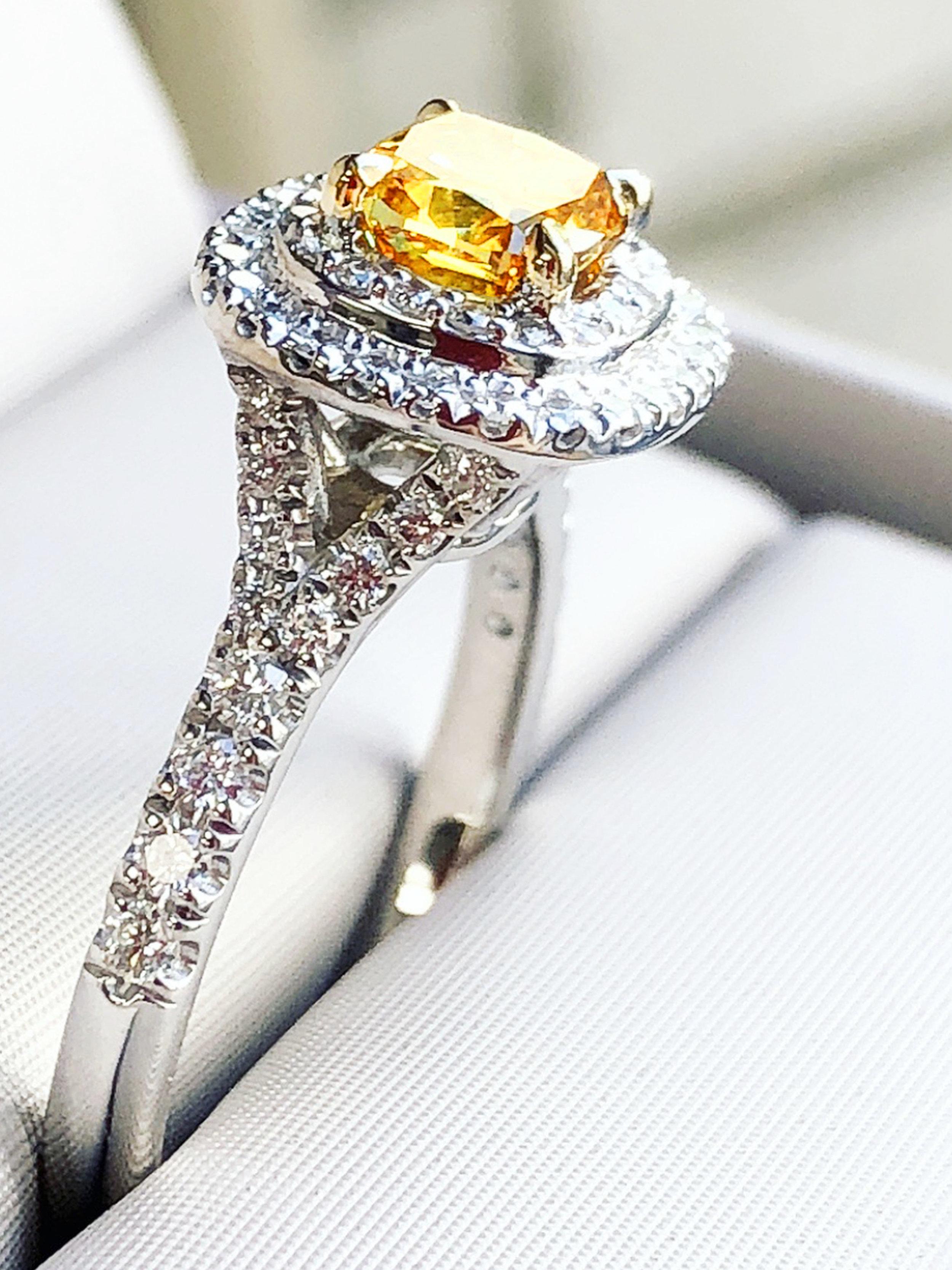 The ORANGE diamond.Double row of white diamonds feature a rarer than rare, orange diamond. A fresh, unique and captivating piece. -