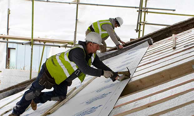 On new build or replacement pitched roofs, the ideal build up would be insulation fitted over and then between the rafters — giving a big boost for airtightness