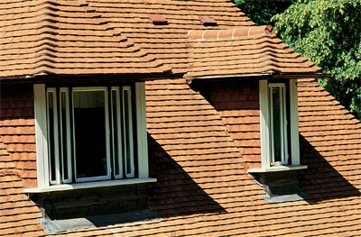 The roof of the dormer itself should at least refer to the style of the main roof, as in this case