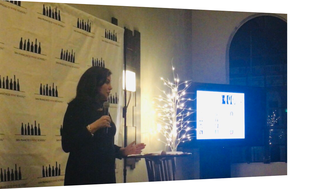 Deborah Farone of Farone Advisors presents at Bubbles, Bites & Bits of Wisdom, Dec. 13, 2018.