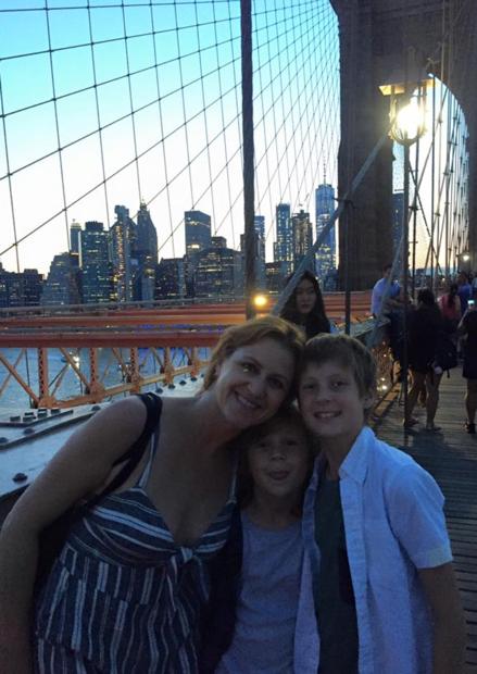Kim with her kiddos on the Brooklyn Bridge