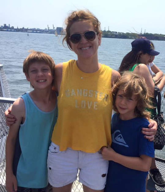 Kim with her kiddos on the ferry.