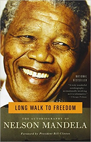 Nelson Mandela's Autobiography - If you ever think you're going through a rough time in your life- read this book. He became my personal hero.