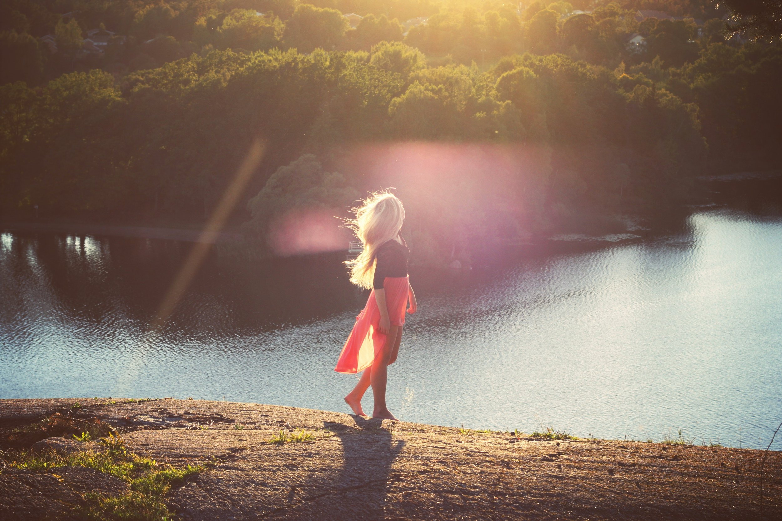 woman walking red sun.jpg
